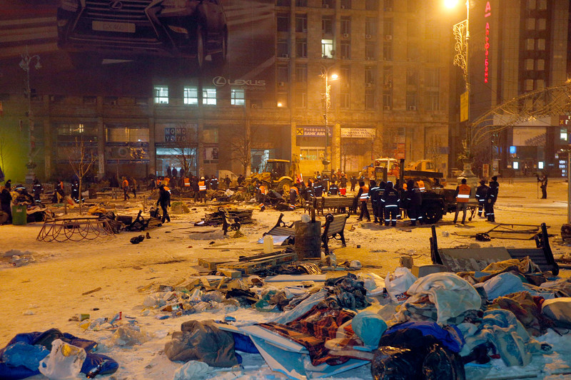 . Municipal employees destroy barricades of pro-EU protester at Independence Square in Kiev, Ukraine, 11 December 2013. Ukrainian riot police reoccupied part of the square where thousands of pro-European protesters demand early elections and resist calls from police to vacate the central Independence Square.  EPA/SERGEY DOLZHENKO