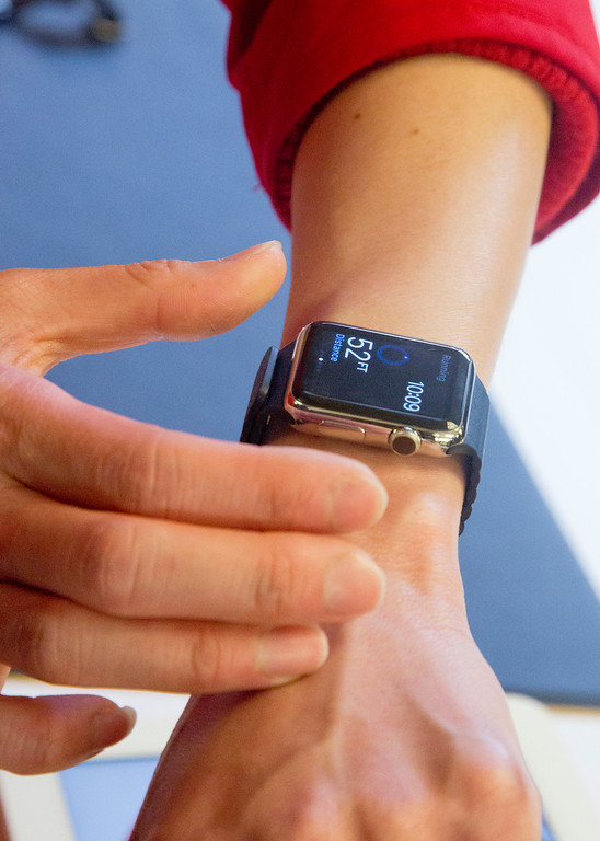 . A customer wears a demo version of Apple\'s new watch which could only be bought pre-order online, Friday, April 10, 2015, in New York.  The first new gadget under CEO Tim Cook is selling in eight countries and Hong Kong, with shipments scheduled to start April 24.  (AP Photo/Bebeto Matthews)