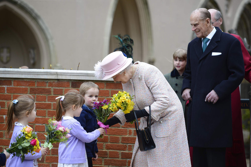 Description of . Queen Elizabeth II and Prince Philip, Duke of Edinburgh arrive for the Easter service at St George's Chapel in the grounds of Windsor Castle on March 31, 2013 in Windsor, England. (Photo by Paul Hackett - WPA Pool/Getty Images)