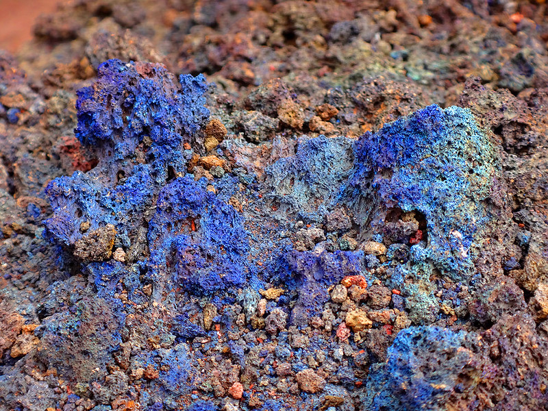 The landscape is littered with mysterious, coloured, melted stones, reminiscent of dragon fire damage
