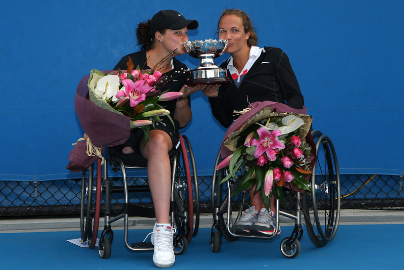 . Jiske Griffioen of the Netherlands and Aniek Van Koot of the Netherlands pose with the trophy after winning their Women\'s Wheelchair Doubles Final match against Lucy Shuker of Great Britain and Marjolein Buis of the Netherlands during day twelve of the 2013 Australian Open at Melbourne Park on January 25, 2013 in Melbourne, Australia.  (Photo by Robert Prezioso/Getty Images)