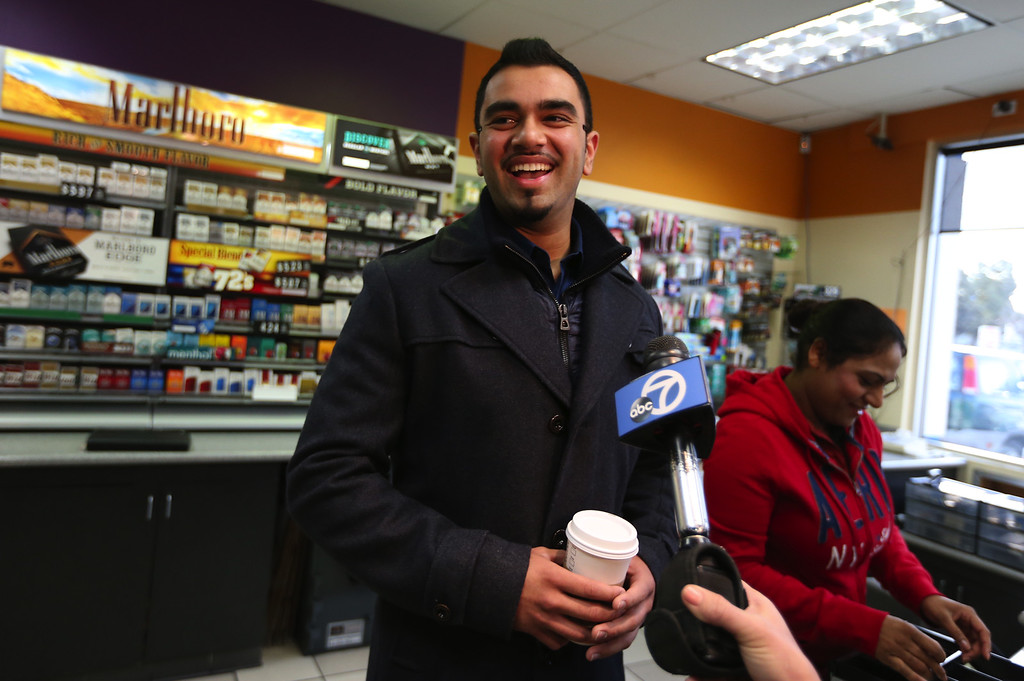 . Parmeet Singh, the Dixon Landing Chevron gas station owners\'s son, speaks to the news media about their station selling the winning Powerball lottery ticket worth $425 Million in Milpitas, Calif., Thursday, Feb. 20, 2014. (Anda Chu/Bay Area News Group)