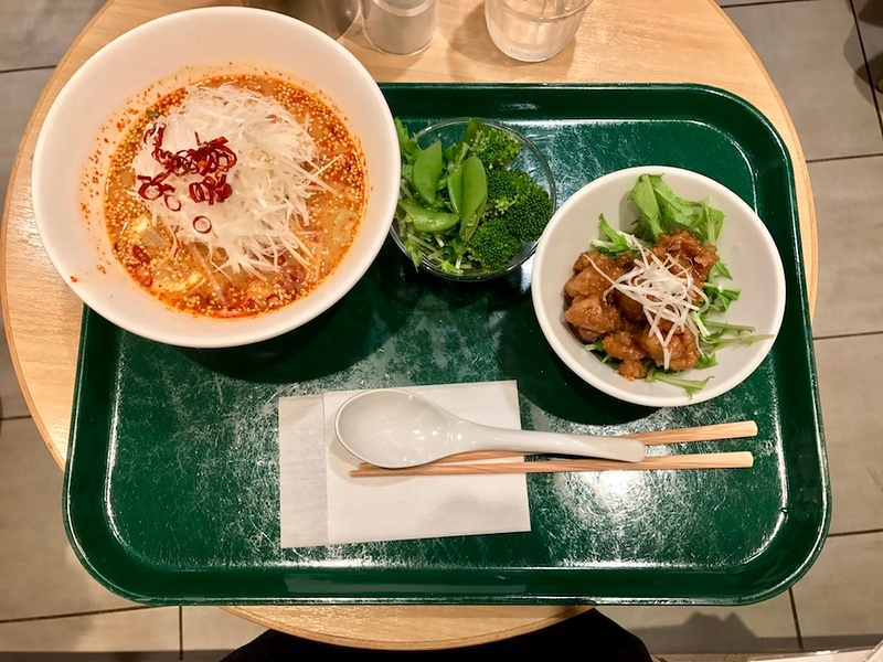 Shiro tantan ramen bowl, vegetable toppings and deep-fried soy meat.