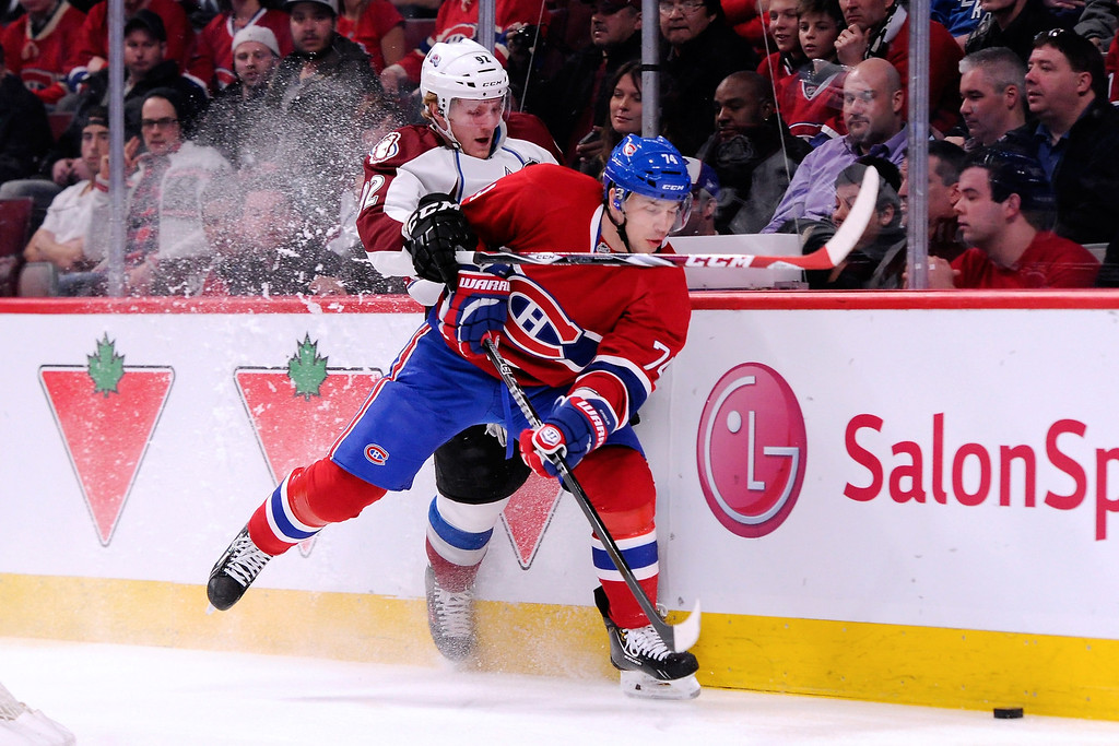 . MONTREAL, QC - MARCH 18:  Alexei Emelin #74 of the Montreal Canadiens and Gabriel Landeskog #92 of the Colorado Avalanche battle for the puck during the NHL game at the Bell Centre on March 18, 2014 in Montreal, Quebec, Canada.  (Photo by Richard Wolowicz/Getty Images)