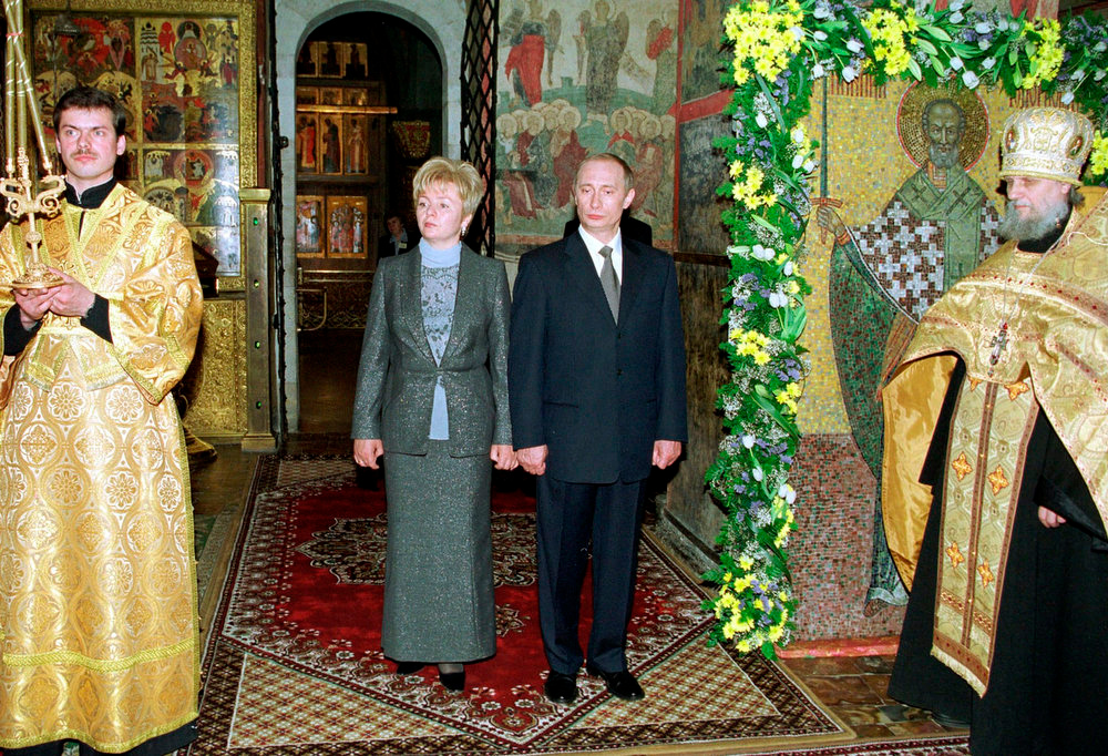 . Russian President Vladimir Putin and his wife Lyudmila enter the Blagoveshchensky Cathedral in Moscow in this undated file photo. Putin and his wife, Lyudmila, said on state television on Thursday that they had separated and their marriage was over after 30 years. REUTERS/Stringer/Files