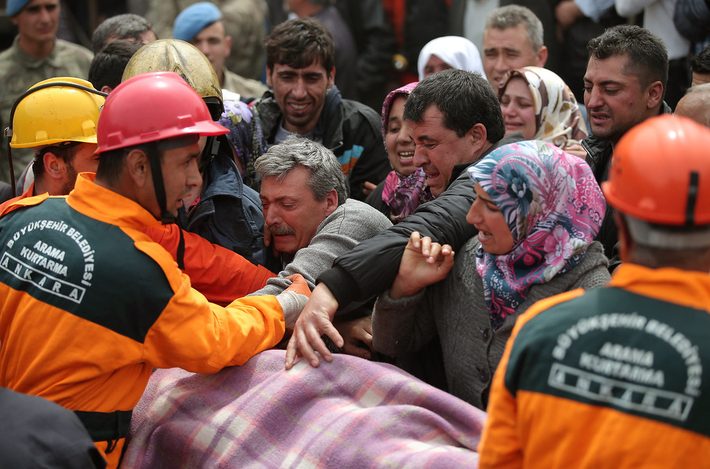 . Rescue workers carry the dead body of a miner outside the mine in Soma, some 250 kilometers (155 miles) south of Istanbul, early Wednesday, May 14, 2014.  (AP Photo/Emrah Gurel)
