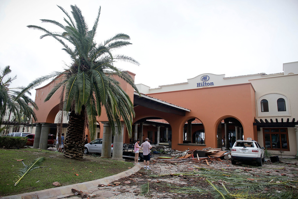 . The entrance of the Hilton hotel is filled with debris caused by Hurricane Odile in Los Cabos, Mexico, Monday, Sept. 15, 2014.  (AP Photo/Victor R. Caivano)