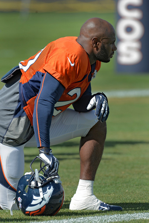 . Denver Broncos SS Mike Adams (20) takes a knee during training camp August 6, 2013 at Dove Valley. (Photo By John Leyba/The Denver Post)