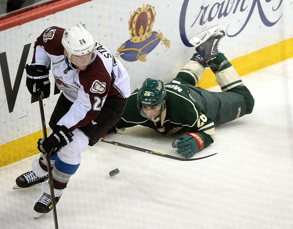 . Minnesota\'s Matt Moulson slides on the ice after colliding with Colorado\'s Paul Stastny during the second period.  (Pioneer Press: Sherri LaRose-Chiglo)