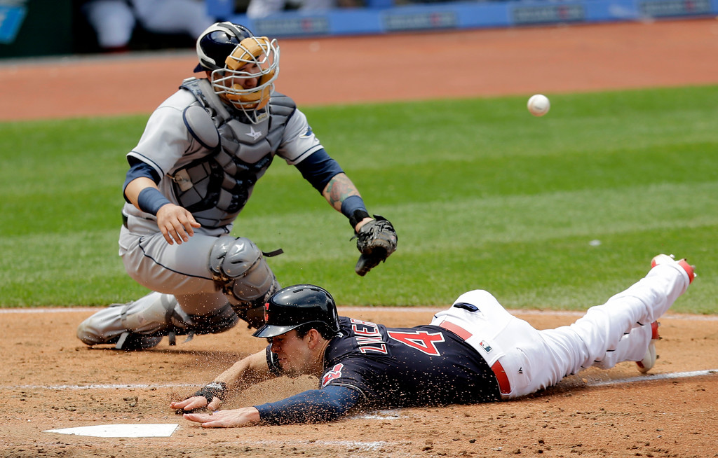 . Cleveland Indians\' Bradley Zimmer slides safely into home plate as Tampa Bay Rays catcher Jesus Sucre can\'t hold onto the ball in the third inning of a baseball game, Wednesday, May 17, 2017, in Cleveland. Zimmer scored on Jason Kipnis\'s single. (AP Photo/Tony Dejak)