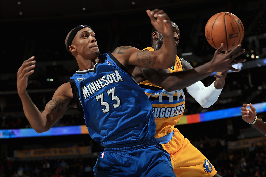 . DENVER, CO - NOVEMBER 15:  J.J. Hickson #7 of the Denver Nuggets grabs a rebound away from Dante Cunningham #33 of the Minnesota Timberwolves at Pepsi Center on November 15, 2013 in Denver, Colorado. (Photo by Doug Pensinger/Getty Images)