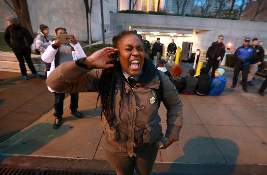 . Ashley Yates leads a chant with protesters in front of the Thomas F. Eagleton U.S. Courthouse in downtown St. Louis on Wednesday, Dec. 3, 2014, hours after a white New York police officer was not indicted in the choking death of Eric Garner. (AP Photo/St. Louis Post-Dispatch, Christian Gooden) EDWARDSVILLE INTELLIGENCER OUT; THE ALTON TELEGRAPH OUT