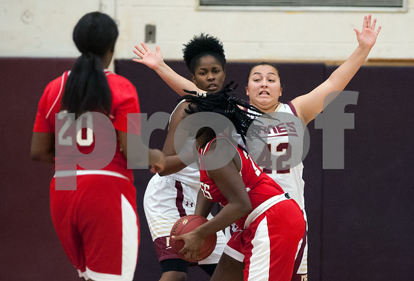 12/29/17 Wesley Bunnell | Staff New Britain basketball was defeated by visiting Wilbur Cross 56-28 on Friday evening at New Britain High School. Gabby Roy (42) on defense.