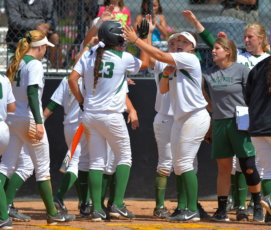 . Cal Poly players congratulate Courtney Tyler after scoring in the 7th inning as LBSU lost to Cal Poly softball 3-0 in Long Beach, CA on Sunday, May 4, 2014.  (Photo by Scott Varley, Daily Breeze)