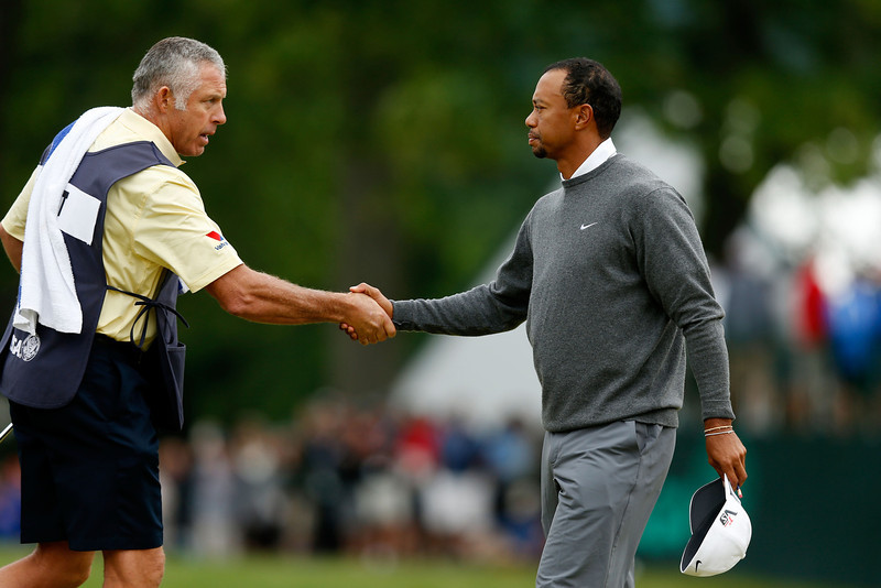 . Caddie Steve Williams and Tiger Woods of the United States shake hands on the 18th green during a continuation of Round One of the 113th U.S. Open at Merion Golf Club on June 14, 2013 in Ardmore, Pennsylvania.  (Photo by Scott Halleran/Getty Images)