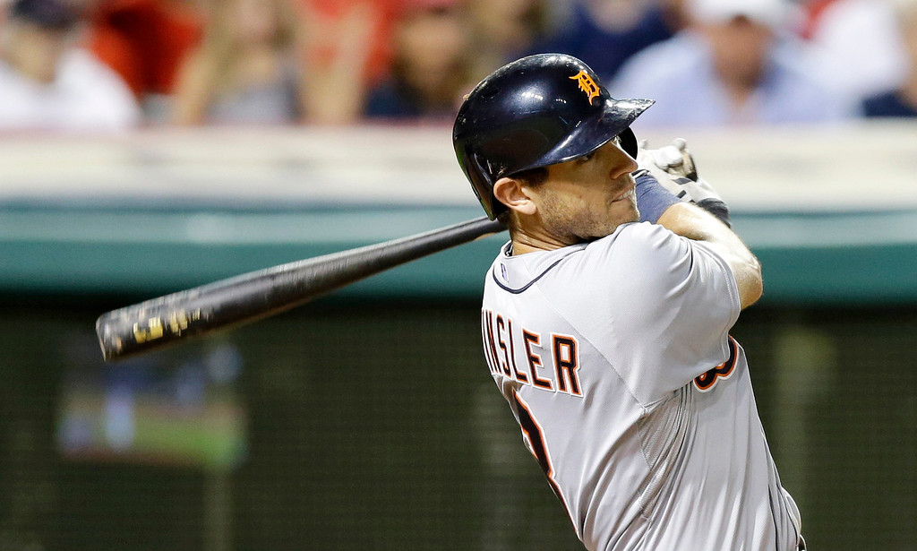 . Detroit Tigers\' Ian Kinsler hits an RBI-double off Cleveland Indians relief pitcher Carlos Carrasco in the ninth inning of a baseball game on Friday, June 20, 2014, in Cleveland. Tigers\' Rajai Davis scored on the hit. (AP Photo/Tony Dejak)