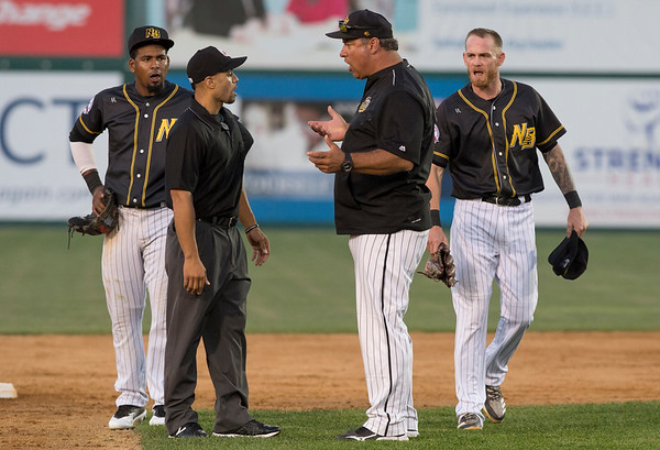 09/03/19 Wesley Bunnell | StaffrrThe New Britain Bees defeated the Somerset Patriots 7-6 in the bottom of the 8th on what was scheduled to be a 7 inning first game of a doubleheader. Manager Mauro Gozzo argues with third base umpire Eric Carmona after Carmona ejected Ryan Jackson (8), R, from the game after Jackson argued a close play at second base.