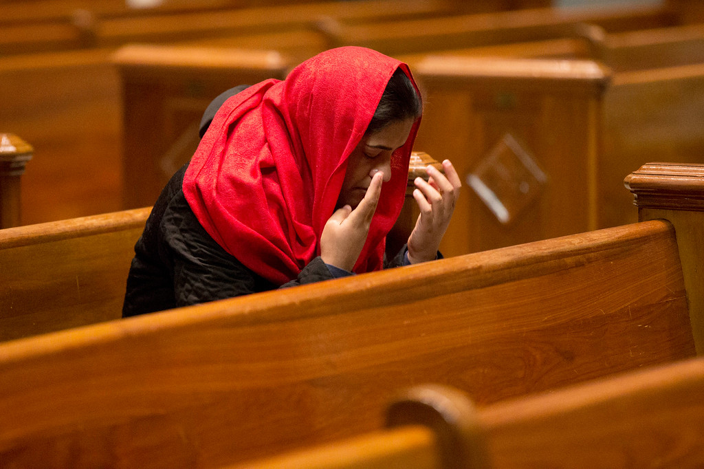 . A worshiper prays before an Ash Wednesday Mass at the Cathedral Basilica of Saints Peter and Paul in Philadelphia on Wednesday, Feb. 18, 2015.  Ash Wednesday marks the start of the Lent, a season of prayer and fasting for Christians before Easter.(AP Photo/Matt Rourke)