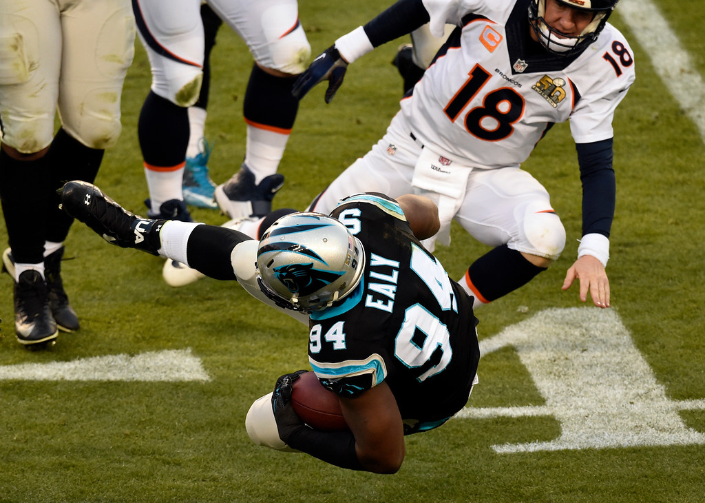 . SANTA CLARA, CA - FEBRUARY 7: Kony Ealy (94) of the Carolina Panthers carries the ball after an interception in the second quarter.  The Denver Broncos played the Carolina Panthers in Super Bowl 50 at Levi\'s Stadium in Santa Clara, Calif. on February 7, 2016. (Photo by John Leyba/The Denver Post)