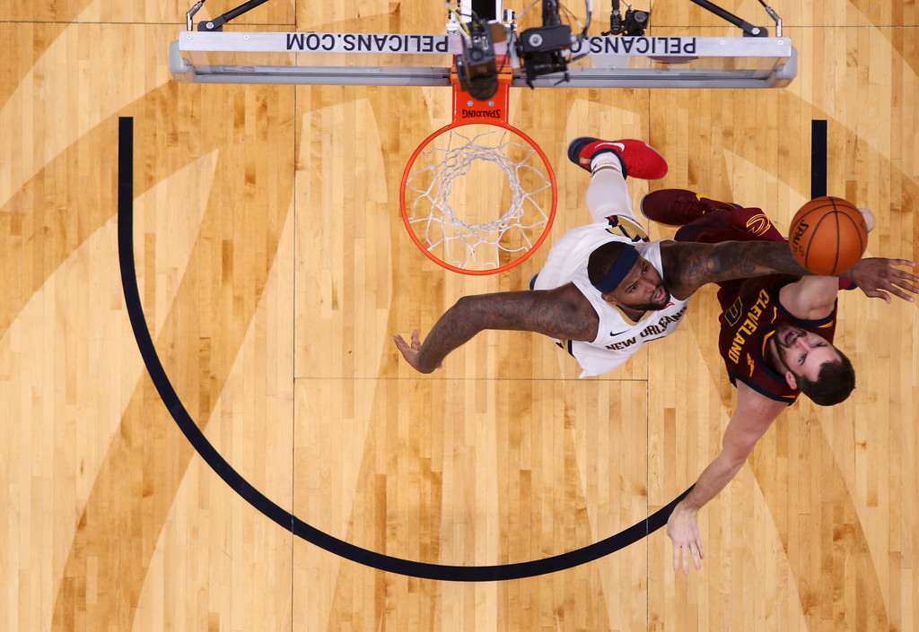 . New Orleans Pelicans forward DeMarcus Cousins, left, challenges Cleveland Cavaliers forward Kevin Love (0) as he goes to the basket in the second half of an NBA basketball game in New Orleans, Saturday, Oct. 28, 2017. The Pelicans won 123-101. (AP Photo/Gerald Herbert)