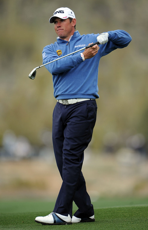 . MARANA, AZ - FEBRUARY 21:  Lee Westwood of England looks on after he hit a shot on the first playoff hole hole during the first round of the World Golf Championships - Accenture Match Play at the Golf Club at Dove Mountain on February 21, 2013 in Marana, Arizona. Round one play was suspended on February 20 due to inclimate weather and is scheduled to be continued today.  (Photo by Stuart Franklin/Getty Images)