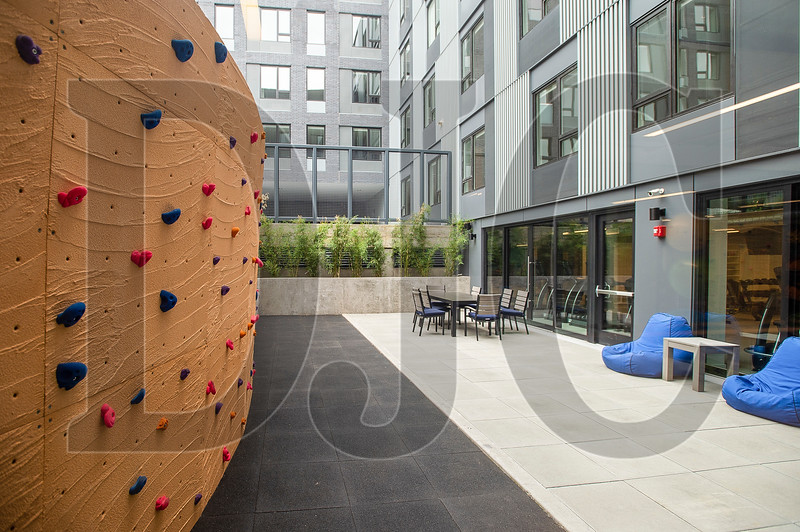 A small outdoor climbing wall caters to residents seeking a taste of the outdoors. (Josh Kulla/DJC)