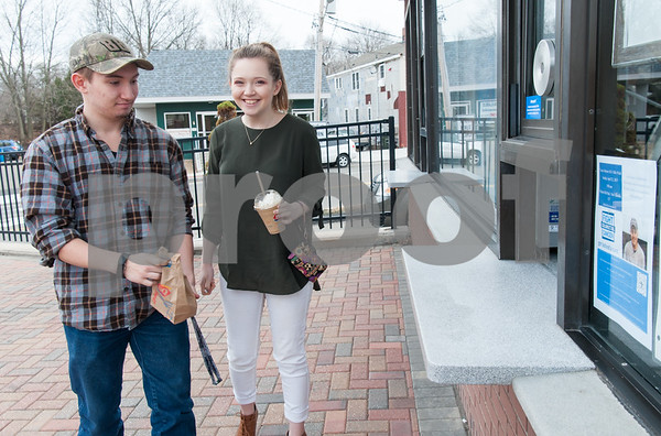 03/01/18 Wesley Bunnell   Staff Berlin High School students Richard and Erin Scalora leave with their orders at Dairy Queen in Kensington on its first day of business for 2018 on Thursday.