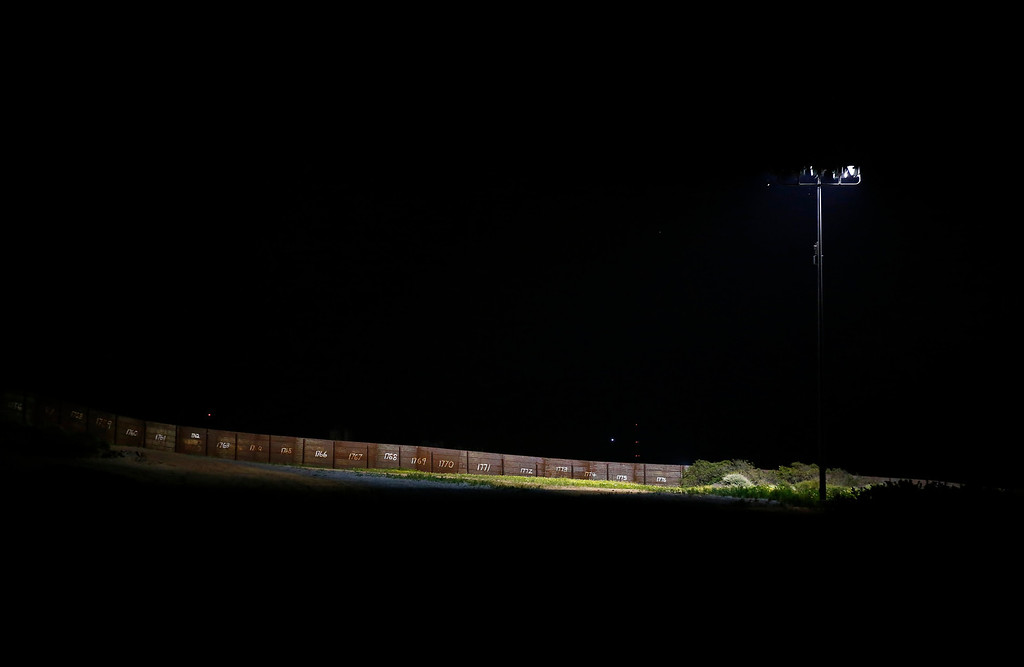 . The primary fence is shown at night along the international border between Mexico and the United States near San Diego, California, March 26, 2013. Picture taken March 26, 2013. REUTERS/Mike Blake