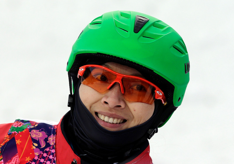 . China\'s Li Nina smiles after a jump during the women\'s freestyle skiing aerials qualifying at the Rosa Khutor Extreme Park, at the 2014 Winter Olympics, Friday, Feb. 14, 2014, in Krasnaya Polyana, Russia. (AP Photo/Andy Wong)