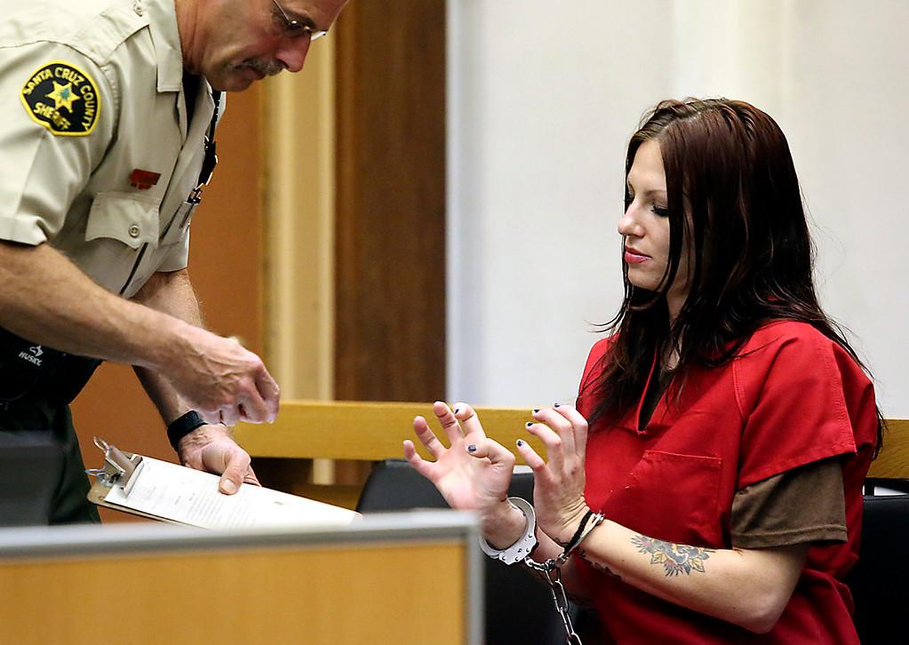 . Santa Cruz County Sheriff\'s Deputy Chuck Beckman fingerprints Alix Tichleman as she appears in Santa Cruz county Superior Court Wednesday to face manslaughter charges. (Shmuel Thaler -- Santa Cruz Sentinel)