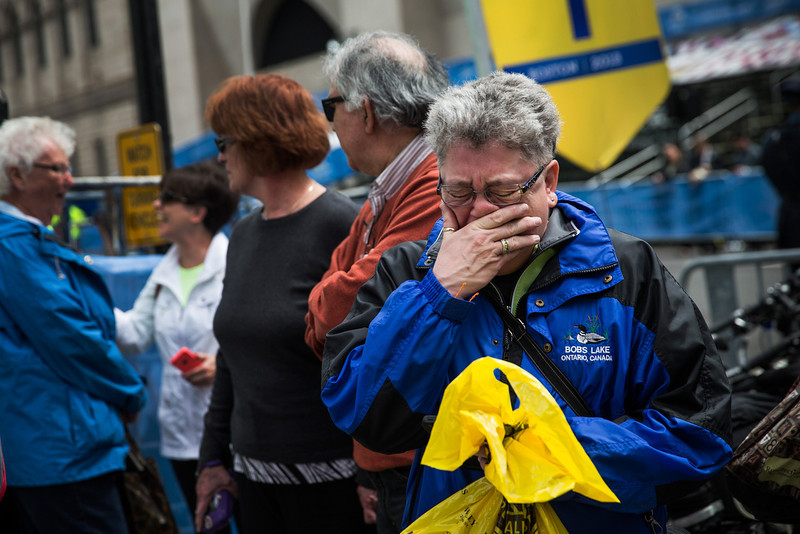 . Sharon Neary, of Rochester, New York, cries while watching a billboard television screen broadcasting the ceremony commemorating the one year anniversary of the 2013 Boston Marathon Bombing , on April 15, 2014 in Boston, Massachusetts. Last year, two pressure cooker bombs killed three and injured an estimated 264 others during the Boston marathon, on April 15, 2013. Neary says she was standing near the site of the bombing before it went off.  (Photo by Andrew Burton/Getty Images)