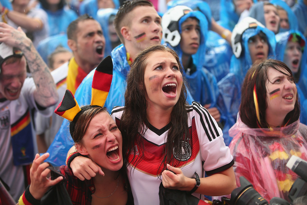 . Germany fans react to play while watching the Germany-USA World Cup match at the Hyundai Fan Park public viewing in front of the Brandenburg Gate in Tiergarten park on June 26, 2014 in Berlin, Germany.  (Photo by Sean Gallup/Bongarts/Getty Images)