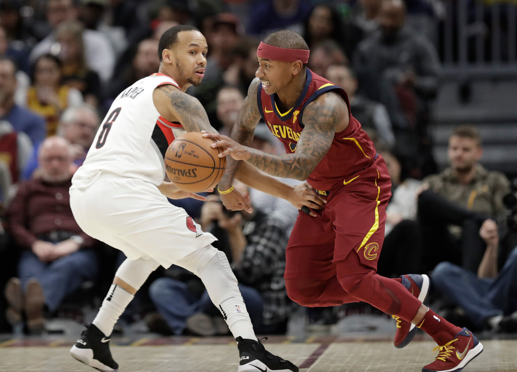 . Cleveland Cavaliers\' Isaiah Thomas, right, drives past Portland Trail Blazers\' Al-Farouq Aminu in the first half of an NBA basketball game, Tuesday, Jan. 2, 2018, in Cleveland. (AP Photo/Tony Dejak)