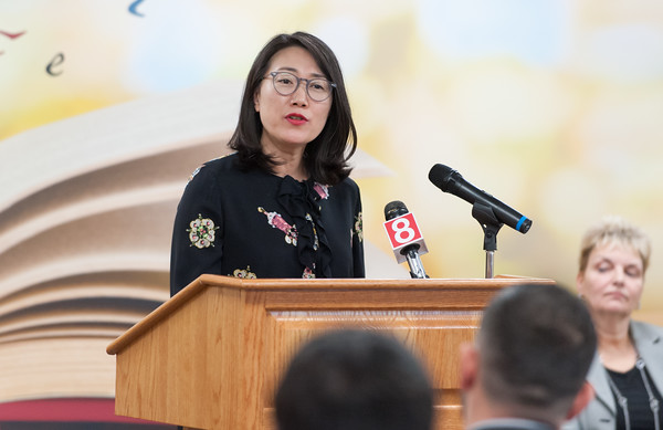 04/10/18 Wesley Bunnell | Staff Director of the New Britain Museum of American Art and a Naturalized US Citizen herself Min Jung Kim speaks her remarks during a naturalization ceremony on Tuesday afternoon at the New Britain Public Library.