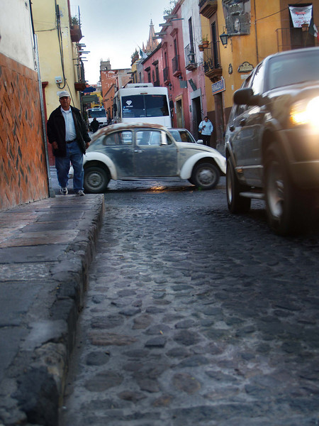 Sharing the narrow streets with pedestrians and cars