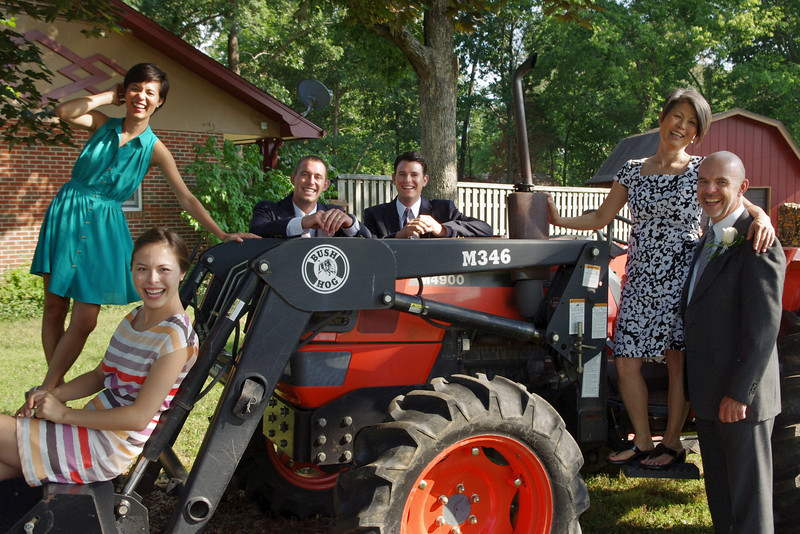 Charles and Sachiko Cantrell, daughters Anna and Sarah with their husbands - fooling around on the tractor. Mountain View Missouri,  June 16, 2012.