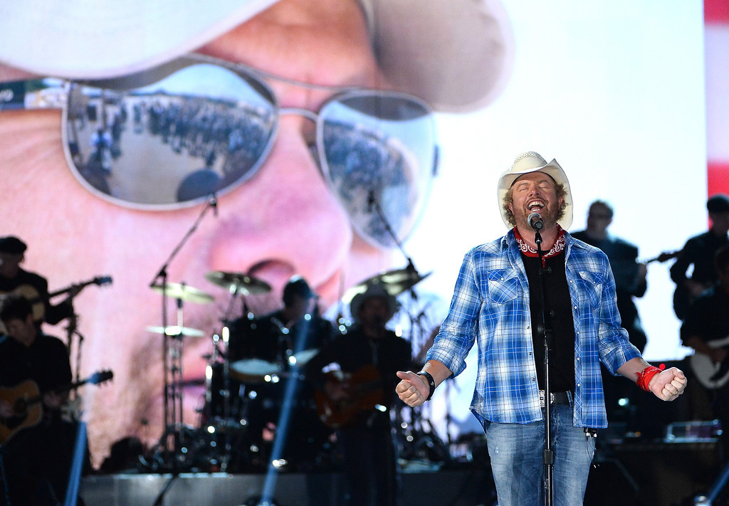 . Musician Toby Keith performs onstage during ACM Presents: An All-Star Salute To The Troops at the MGM Grand Garden Arena on April 7, 2014 in Las Vegas, Nevada.  (Photo by Ethan Miller/Getty Images for ACM)