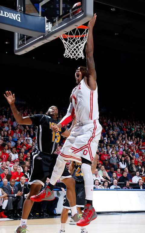 . DAYTON, OH - MARCH 22: Deshaun Thomas #1 of the Ohio State Buckeyes goes up with the ball against David Laury #13 of the Iona Gaels in the second half during the second round of the 2013 NCAA Men\'s Basketball Tournament at UD Arena on March 22, 2013 in Dayton, Ohio.  (Photo by Joe Robbins/Getty Images)