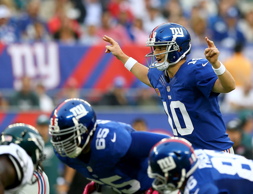 . Eli Manning #10 of the New York Giants calls out the play in the first quarter against the Philadelphia Eagles at MetLife Stadium on October 6, 2013 in East Rutherford, New Jersey.  (Photo by Elsa/Getty Images)
