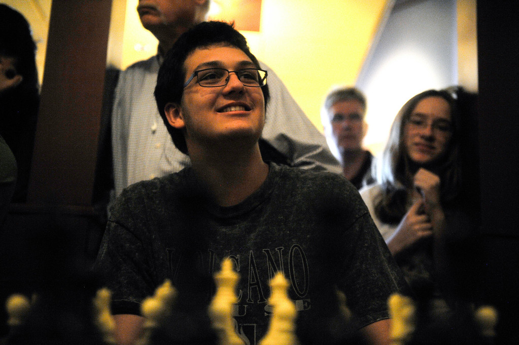 . DENVER CO: Nov. 2, 2013  Gunner Andersen, 15, smiles during gameplay against grand chess master Timur Gareev. Andersen was one of 15 chess players to take on Gareev who was blindfolded during play.   (Photo By Erin Hull/The Denver Post)