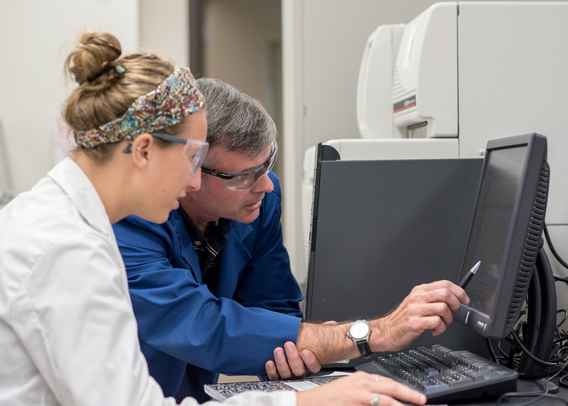 Ashley Hamilton (left) and Dr. Patrick Larkin review research data.