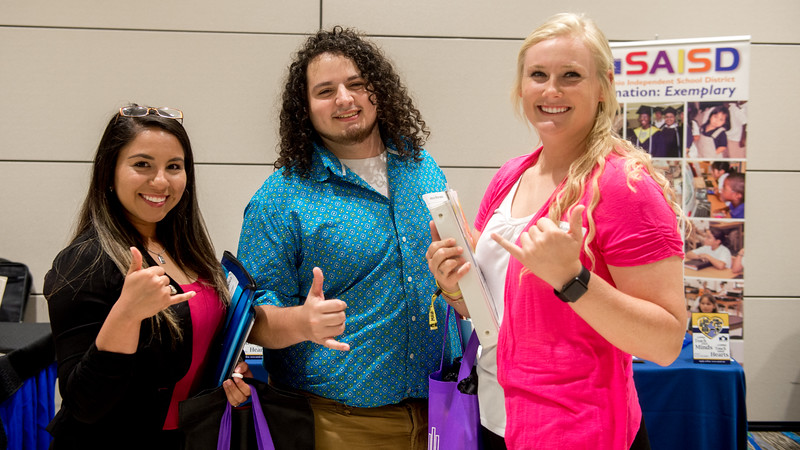 Students Jessica Mendez (left), Jesus Moncada, and Aspen Auger attend the Education Career Fair and show Islander's spirit.