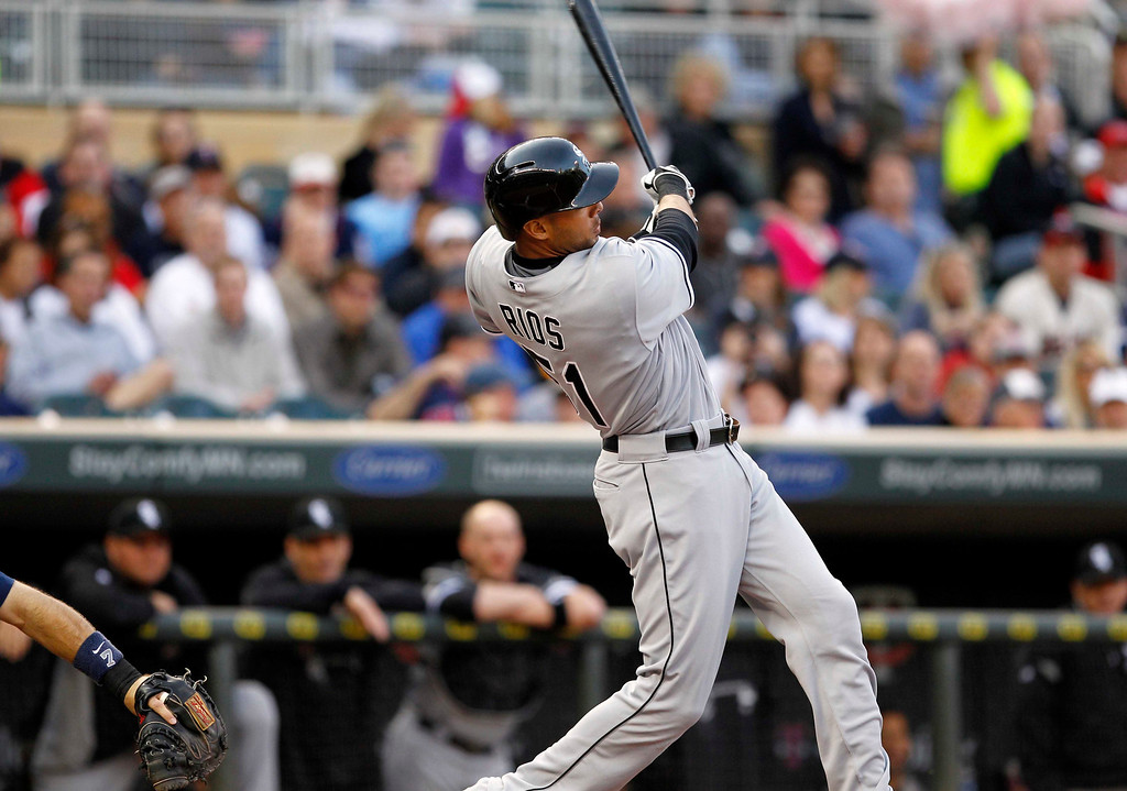 . Chicago White Sox\'s Alex Rios hits an RBI double against Minnesota Twins starting pitcher Pedro Hernandez during the first inning of a baseball game, Monday, May 13, 2013, in Minneapolis. (AP Photo/Genevieve Ross)