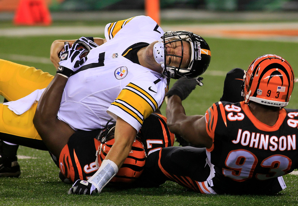 . Pittsburgh Steelers quarterback Ben Roethlisberger (7) is sacked by Cincinnati Bengals defensive tackle Geno Atkins (97) and defensive end Michael Johnson (93) in the second half of an NFL football game, Monday, Sept. 16, 2013, in Cincinnati. (AP Photo/Tom Uhlman)