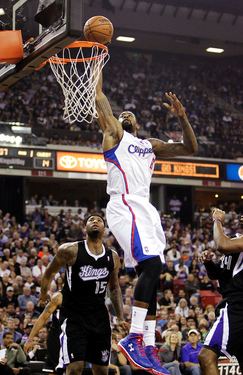 . Los Angeles Clippers center DeAndre Jordan, right, goes to the basket over Sacramento Kings center DeMarcus Cousins, left, during the first quarter of an NBA basketball in Sacramento, Calif., Wednesday, April 17, 2013.(AP Photo/Rich Pedroncelli)