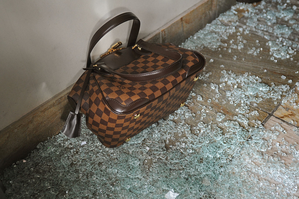 . A purse sits in broken glass in the Neiman Marcus Cafe early Thursday at the Westfield Topanga mall in Canoga Park, CA March 7, 2013.  Three men broke a window in the cafe, cut through a security gate and stole purses from the store.(Andy Holzman/Los Angeles Daily News)