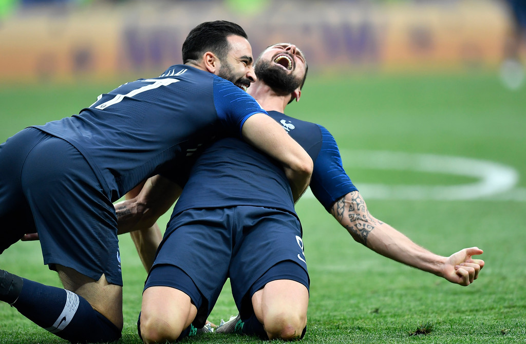 . France\'s Olivier Giroud, right, and Adil Rami celebrate after winning 4-2 during the final match between France and Croatia at the 2018 soccer World Cup in the Luzhniki Stadium in Moscow, Russia, Sunday, July 15, 2018. (AP Photo/Martin Meissner)
