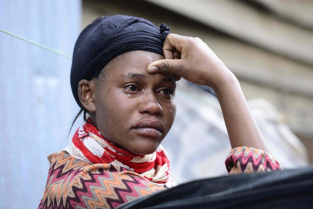 . A Kenyan woman cries as she looks at what used to be her home after a building collapsed in Nairobi on April 30, 2016.  / AFP PHOTO / JOHN MUCHUCHA/AFP/Getty Images