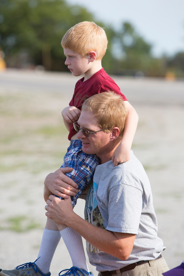 Dan Tangeman, with Jack, 6, from St. Mary's Parish in St. Benedict, KS. Watching a rousing game of gaga ball.