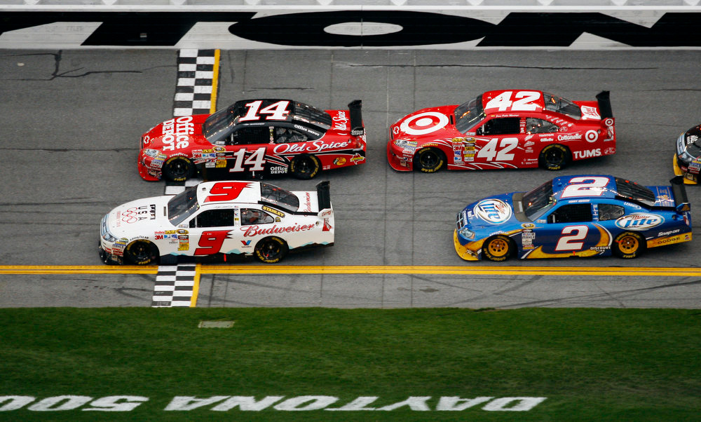 Description of . Driver Kasey Kahne (9) wins the second of two  NASCAR Gatorade Duel qualifying auto races in Daytona Beach, Fla., Thursday, Feb. 11, 2010, beating Tony Stewart (14), Juan Pablo Montoya (42) and Kurt Busch (2) across the finish line. (AP Photo/J Pat Carter)